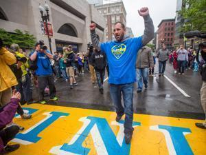 Jarrod Clowery of Stoneham, who was injured in the bombing, was triumphant after crossing the finish line on Boylston Street.