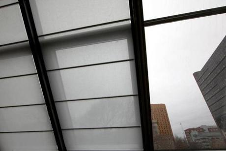 BOSTON, MA. 12/ 145/ 2011:Windows with shades down where artist Daniel Harvey in the Gardner's Museum artist-in-residence apartment. ( David L Ryan / Globe Staff Photo ) SECTION :ARTS TOPIC : 15residence REPORTER