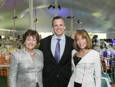 STEP UP: Event cochairs Holly Safford and Joan Parker flanked honoree Rufus Gifford at a Greater Boston Parents, Families and Friends of Lesbians and Gays benefit in the Back Bay Fens on May 16.
