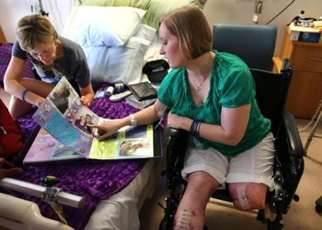 Erika Brannock showed her mother, Carol Downing, a photo album given to her by the medical staff who cared for her.
