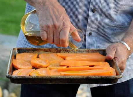 Show host Pete Evans drizzled oil on sweet potatoes.