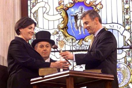 Boston, MA - State House - 4/10/01 - Staff Photo: Barry Chin. Departing Gov. Paul Cellucci prepares to hand over a gavel to new Govenor Jane M. Swift as part of a State House transition Ceremony today.