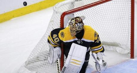 Tuukka Rask made a save against the Penguins during the first period.