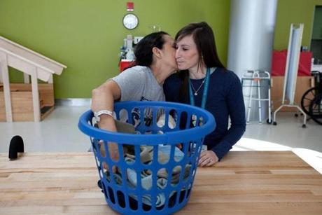 Survivor Martha Galvis kissed therapist Samantha Geary on the cheek after an exercise folding laundry.