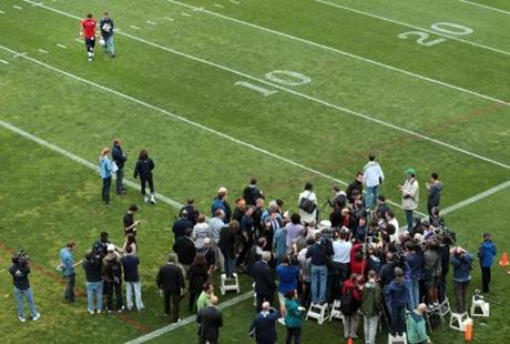 Quarterback Tim Tebow was accompanied by Stacey James, vice president of media relations, as he prepared to face the press at Gillette Stadium on his first day as a New England Patriot.