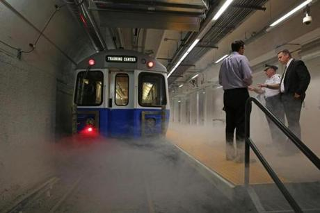 Smoke poured from a train during a fire simulation in the MBTA's new emergency training center.