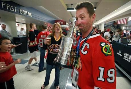 A Blackhawks fan carried a mini Stanley Cup, but refused to let a Bruins fan pose for a photo with it, before Game One of the Stanley Cup Finals hockey series at the United Center in Chicago.
