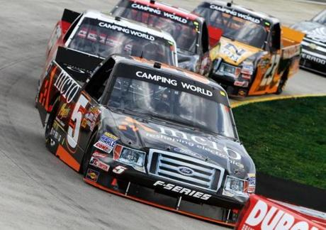 Harraka leads a pack during a NASCAR Camping World Truck Series race last year.
