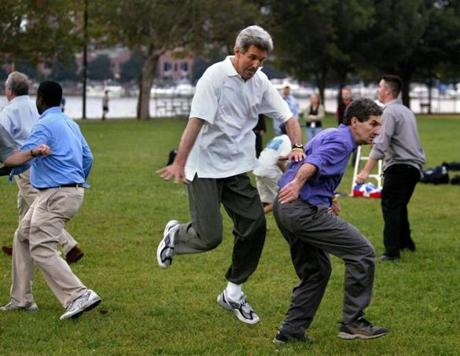 Senator John Kerry bounded over his brother, Cameron Kerry on the Esplanade in Boston in 2004. Throughout his life, Cameron has been dedicated to his brother's politcal career.