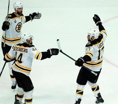 The game started on a high note for the Bruins, when Milan Lucic, right, scored in the first period to give Boston a 1-0 lead.
