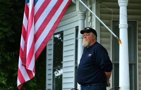 Hudson resident Jim Rittenhouse watched from his front steps.