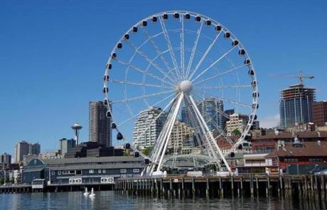 The Seattle Great Wheel opened last June and rises 175 feet above Elliott Bay.
