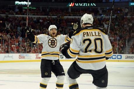 The Bruins' Daniel Paille (right) scored the game-winning goal 13:48 into overtime of Game 2.