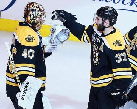 Tuukka Rask (left) and the Bruins beat the Blackhawks 2-0 in Game 3 of the Stanley Cup Final, with Patrice Bergeron (right) scoring one of the goals.