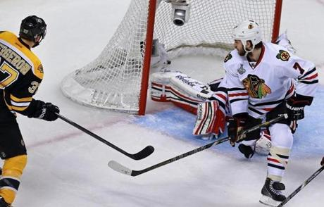 Bergeron provided the game-icing goal in the second period when he slipped this shot past Chicago's Corey Crawford.