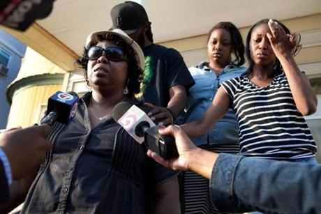 Ursula Ward (far left), mother of Odin Lloyd, gave a statement to the press outside of her home in Dorchester.