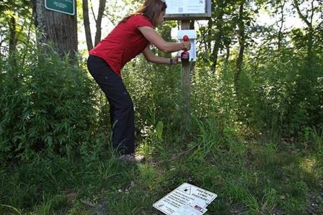 Weston conservation administrator Michele Grzenda installed tick information boxes in Burchard Park.