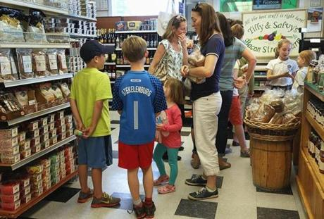 Families shopping at Tilly & Salvy's on a recent visit reflect the relaxed, friendly atmosphere nurtured by its owners.