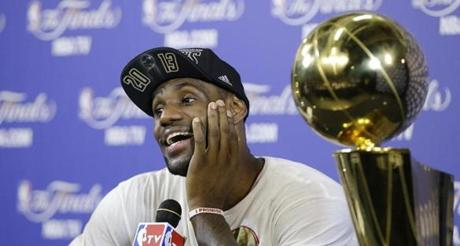 LeBron James smiled during a postgame news conference after he and the Heat won the NBA Finals.