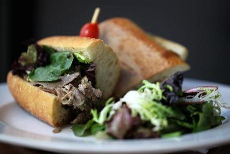 Boston, MA 062213 Duck confit sandwich from Bread + Butter in the North End, Saturday, June 22 2013. (Staff Photo/Wendy Maeda) section: Arts slug: 30quickbite reporter: Devra First