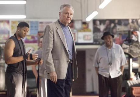 Jon Voight (center, with Pooch Hall and William Stanford Davis) plays the title character's father, an ex-convict.