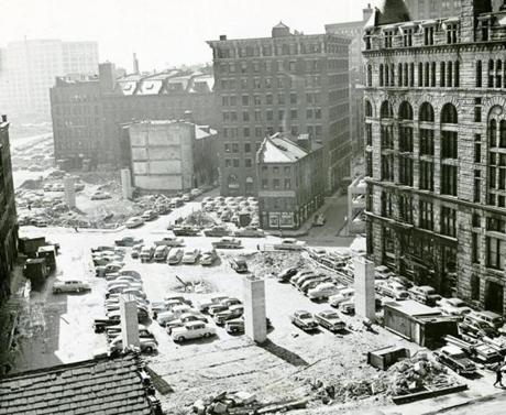 May 17, 1954:  As the demolition teams cleared the way for Boston's Central Artery, they uncovered a new Boston. Buildings walled in by often taller structures stood out clearly. Every building of major historical importance was saved. Here the view is looking south toward the Harbor Building on Atlantic Ave. (left background). In foreground are three reinforced concrete piers for the future elevated, six-lane expressway.