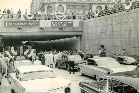 June 25, 1959: Crowds gathered at Kneeland Street for the official opening of the downtown segment of the John F. Fitzgerald Expressway and the Southeast Expressway. Governor Foster Furcolo opened the new highway at exercises which began at 10 a.m. on the Central Artery near the tunnel entrance. The long-awaited access to the South Shore opened eight months ahead of schedule. Special equipment and machinery were used during the winter months to cope with elements that may have otherwise delayed construction.