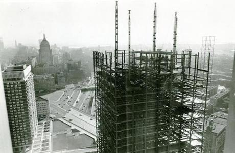 September 30, 1969: The 28-story Prudential office building under construction is viewed from the 28th floor of the Pru Tower. The Massachusetts Turnpike and the Back Bay business area are at left.