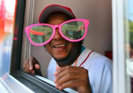 Former Red Sox pitcher Pedro Martinez showed his good humor as he wore some big glasses given to him by a fan as he gave out Good Humor ice cream near the Copley T station as part of the team's