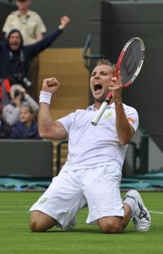 Steve Darcis celebrates after upsetting Rafael Nadal in straight sets at Wimbledon.