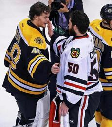 Tuukka Rask saluted his Chicago counterpart Corey Crawford, right, during the traditional handshake.