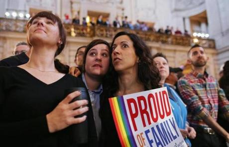 Gay rights supporters awaited the Supreme Court's decisions at San Francisco City Hall.