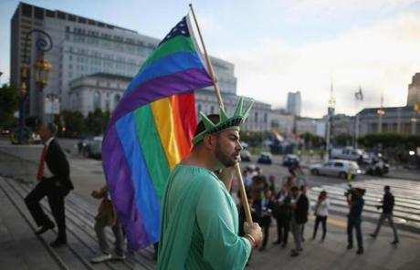 A gay rights supporter waved a flag at City Hall in San Francisco.