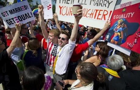 A group of supporters outside the Supreme Court building celebrated after the justices struck down the Defense of Marriage Act.