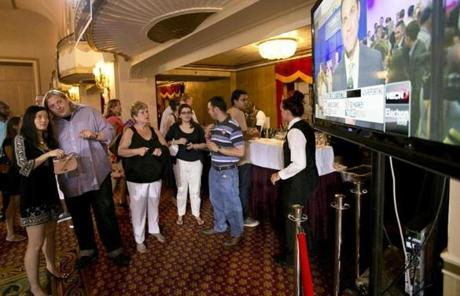 Supporters watched election results come in on television screens at Edward Markey's election night party.
