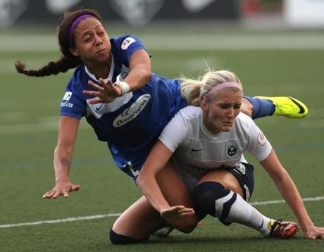 Boston Breakers forward Sydney Leroux (2) battled Seattle Reign midfielder Kaylyn Kyle (6) during a game at Dilboy Stadium in Somerville.