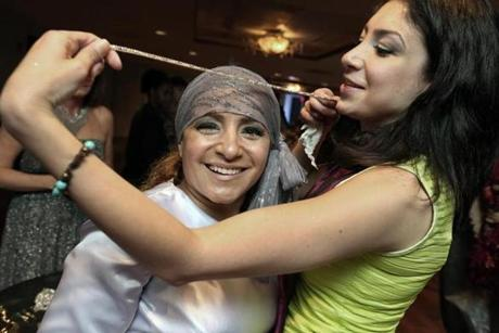 6-27-2013 Boston, Mass. Over 400 guests atttend 2nd Annual Catwalk for Boston Medical Center Cancer Care held at the State Room. L. to R. are Zahra Haghigha of Needham with designer Kinda Touma. Globe photo by Bill Brett