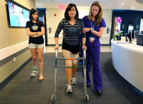 Celeste Corcoran walked on her new prostheses with her daughter Sydney and physical therapist Alyson Jodoin.