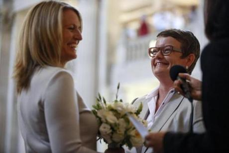 Sandy Stier (left) and Kris Perry were married by California Attorney General Kamala Harris at San Francisco's City Hall.