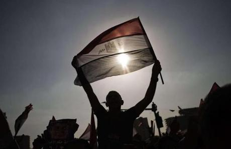 An Egyptian protester waved the national flag in Cairo.