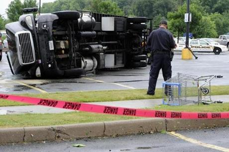 A powerful storm tore through the Connecticut towns of Windsor Locks and East Windsor,  leaving an overturned truck in the parking lot of a Walmart in East Windsor.