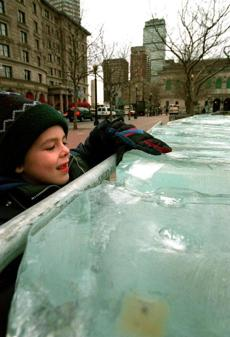 Daniel Landry of Revere stopped to check out the giant blocks of ice in Copley Square.