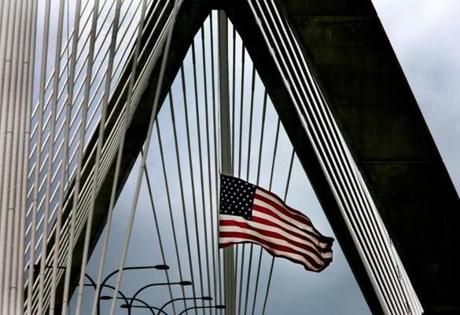 A large American flag blew in the wind over the Leonard P. Zakim Memorial Bridge.