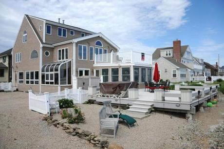 This property in Marshfield includes the beach below the sea wall, which is undergoing an upgrade by the town.