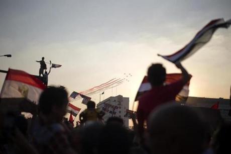 Jubilant Egyptians waved flags as army jets flew over Cairo Thursday.
