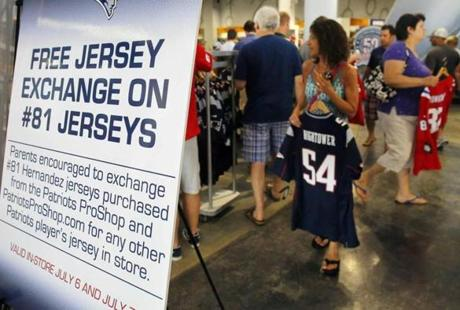 Fans picked out replacement jerseys in exchange for jerseys of former New England Patriots player Aaron Hernandez at the club's ProShop in Foxborough.