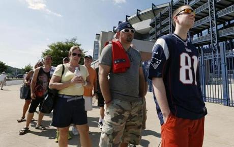 Mike Davies, right, of Norfolk wore his Hernandez jersey one last time while waiting in the exchange line.