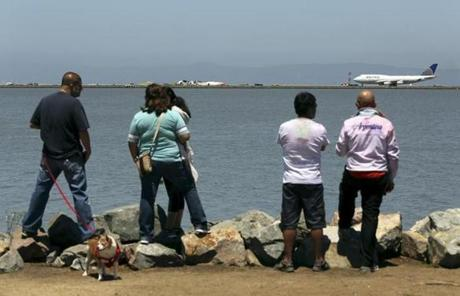 People looked at the scene from a path along San Francisco Bay.