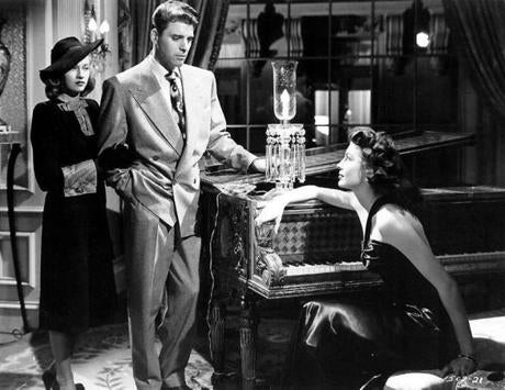 "Lancaster in ""The Killers"" with Virginia Christine, far left, and Ava Gardner."
