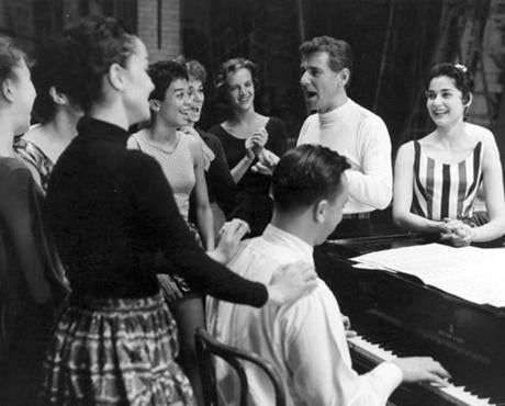 "In 1957, Leonard Bernstein and Stephen Sondheim (at piano) rehearsing the Broadway musical ""West Side Story."" Carol Lawrence (far right) played Maria."